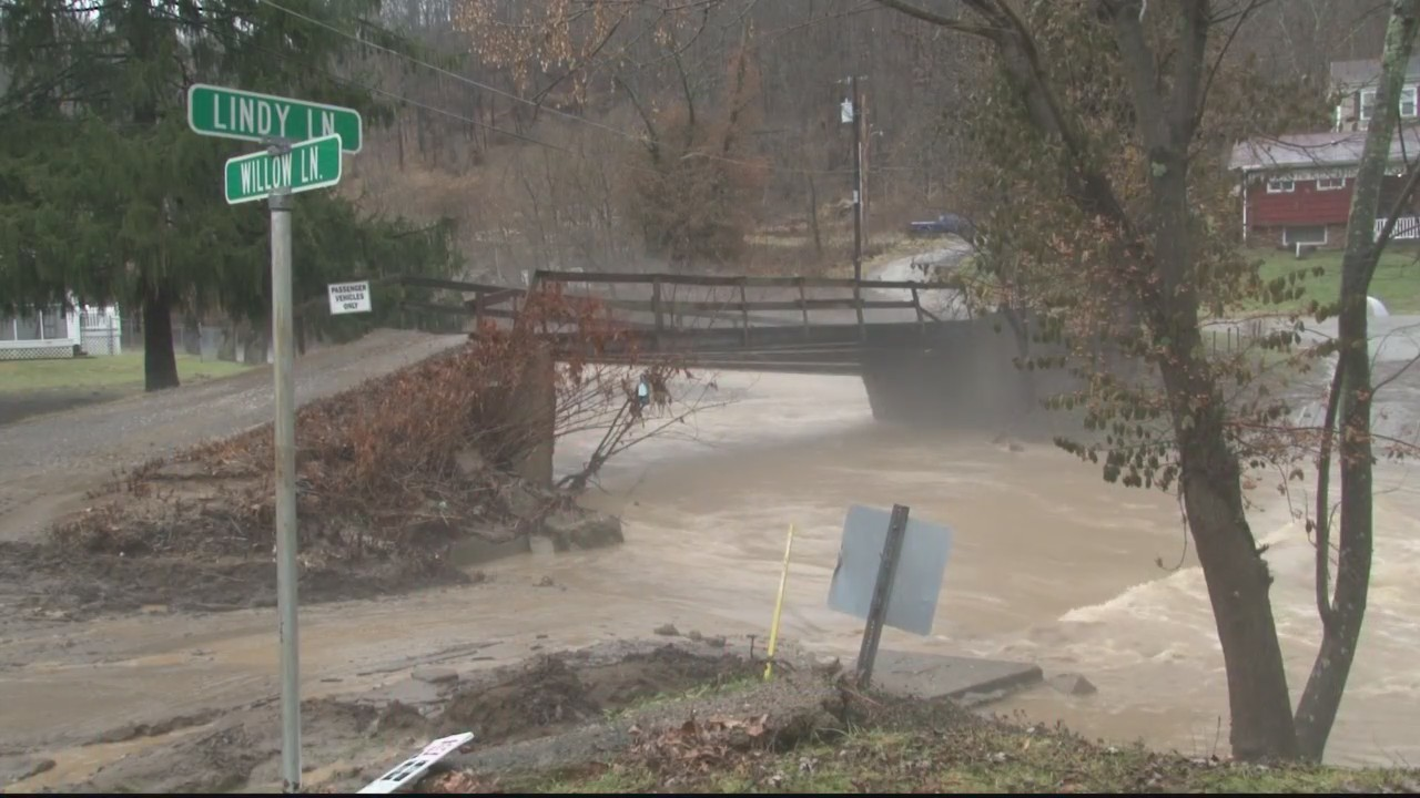 Families stranded after flood washes out bridge